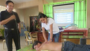 Dr. Bibiano Fajardo explains Hilot while ATHAG Hilot therapist Karen Reyes demonstrates.