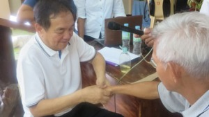 Dr. Bibiano Fajardo performs traditional Hilot on a patient in Bukidnon.