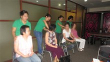 ATHAG therapists perform Hilot's characteristic deep, healing strokes on survivors of breast cancer.
