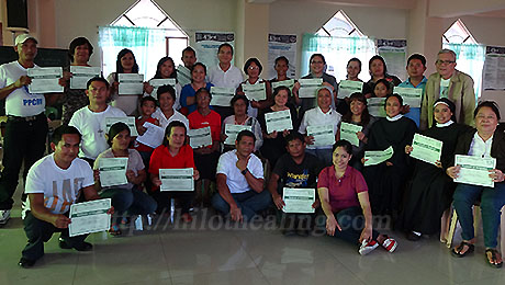 Participants pose for a souvenir photo with Dr. Boy Fajardo, Mrs. Nenita Ma, and Sr. Carol Base after the training on traditional Hilot healing.