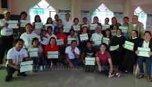 Participants show off their certificates after the training on traditional Hilot healing.