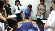 Participants observe ATHAG Hilot Therapist Karisse Alzola demonstrating basic Hilot techniques.