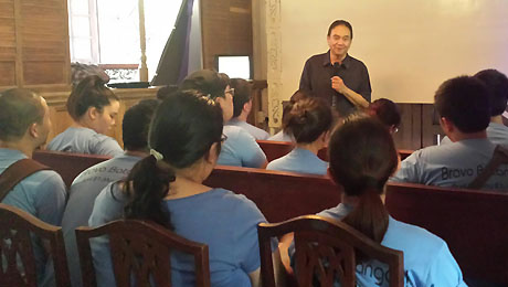 Dr. Bibiano Fajardo explains traditional Hilot to students taking part in Ateneo's Cultural Laboratory 2014 in the province of Batangas.