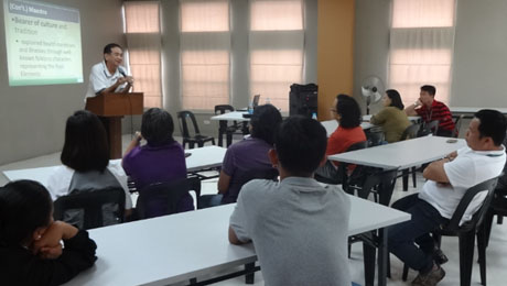 "Dr. Bibiano ""Boy"" Fajardo explains traditional Hilot to the administrative staff of the UP Colllege of Arts and Letters."