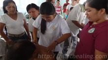 ATHAG manghihilot Maryflor Alvarez teaches participants how to do traditional Hilot healing.