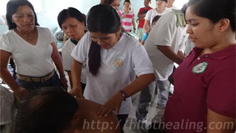 ATHAG manghihilot Maryflor Alvarez (right) teaches participants how to do traditional Hilot healing.