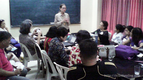 Dr. Patricia Sison, Executive Director of DLS-FLWI, leads the discussion group that ATHAG was part of.