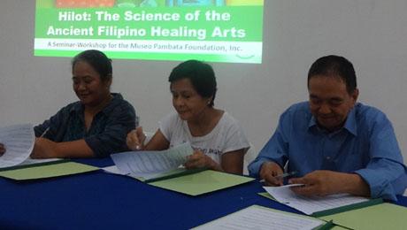 "ATHAG President Bibiano ""Boy"" Fajardo signs a Memorandum of Agreement with Museo Pambata's CEO Ms. Nina Lim-Yuson (center) and Executive Director Maricel Montero (left)."